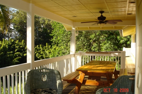 Outdoor covered lanai with gas grill.